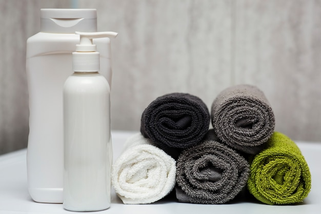 A set for washing hair, shampoo, balm and towels in the bathroom