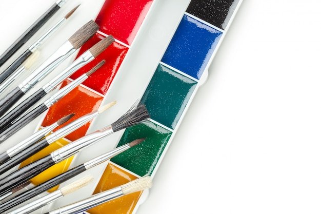 Set of watercolor paints and paintbrushes