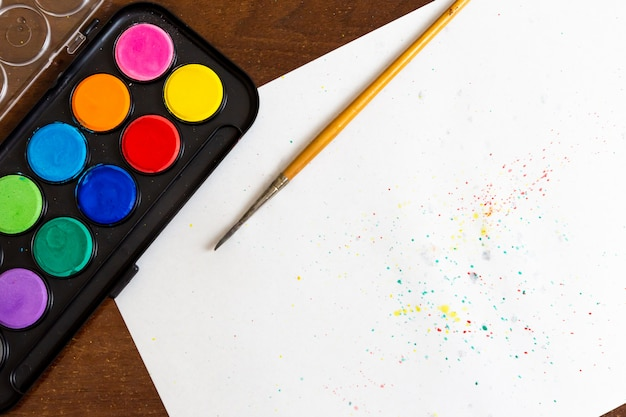 Set of watercolor paints on the white background with copy space for text. trendy drawing materials for creative art