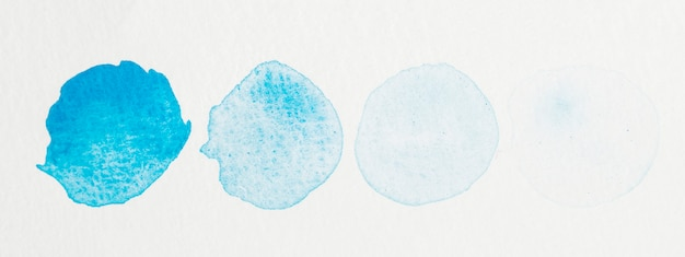 Set of watercolor shapes. blue hand painted circle isolated on white background texture