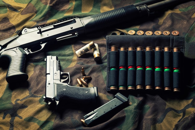Set of weapons of a fighter of a special unit. shotgun, cartridges, gun. top view.