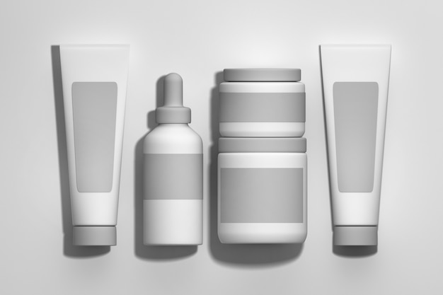 Set of white cosmetics packaging jars, bottles, tubes on white