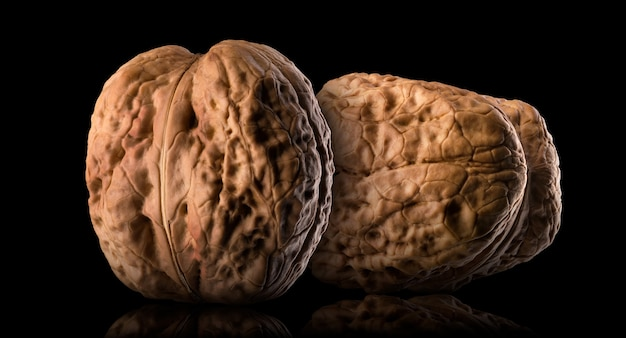 Set of whole walnuts isolated on a black background.