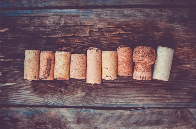 Set of wine corks on a wooden background