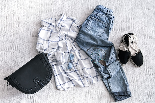 Set with fashionable women's clothing, shirt, jeans, and bag with accessories.