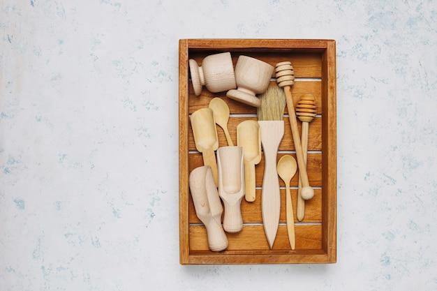 Set of wooden kitchen utensils on concrete surface