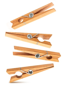 Set of wooden surface clothespins isolated on white