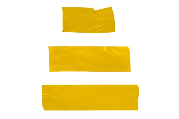 Set of yellow gold torn pieces of scotch tape on a white background