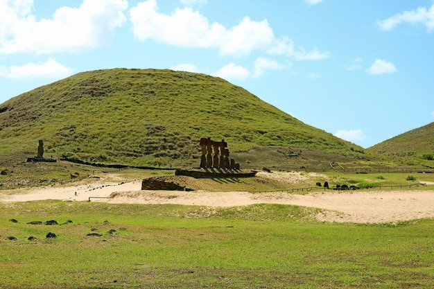Seven moais of ahu nau nau with single moai of ahu ature huki on anakena beach easter island chile