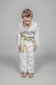 Seven year old caucasian child practicing martial arts. rei position.