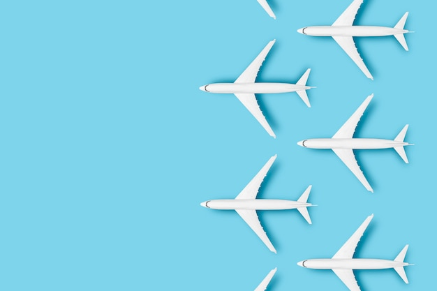 Several airplanes on a blue background. concept travel, airline tickets, flight, pallet route, transfer.