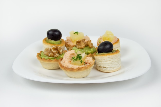 Several beautiful tartlets with different fillings