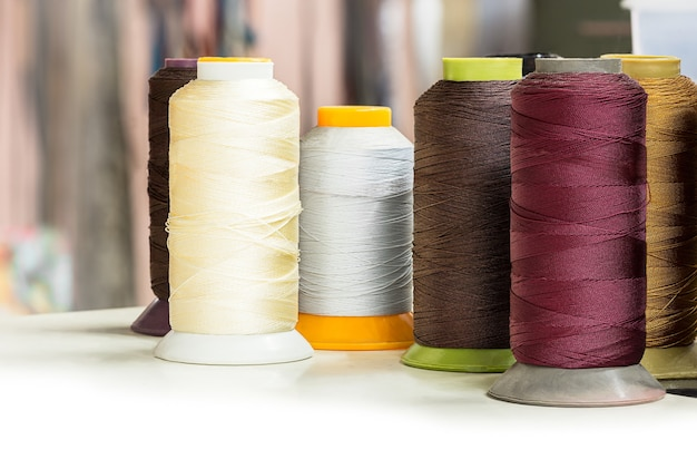 Several bobbins of thread for textile industry