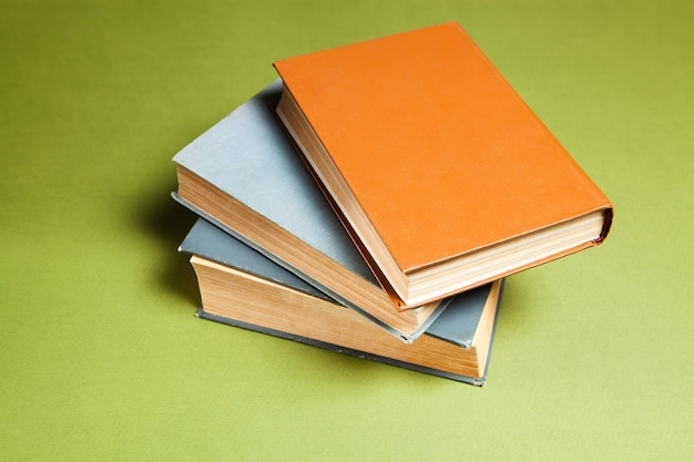 Several books on a green background