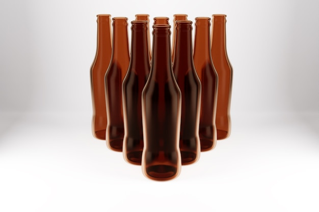 Several brown glass beer bottles stand in the shape of a pyramid on a white isolated background