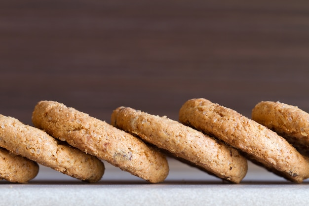 Several chocolate chip cookies on dark background. close-up