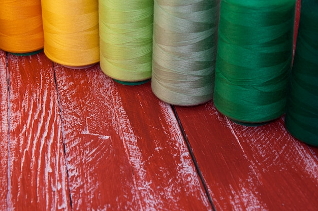 Several of colored spools of thread