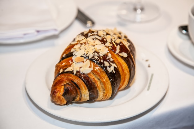 Several croissants are placed on the marble table before serving