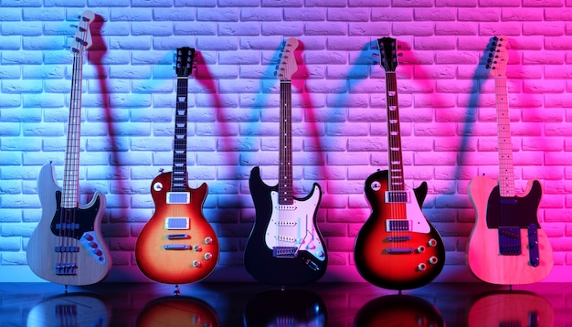 Several electric guitars against a brick wall in neon light, 3d illustration
