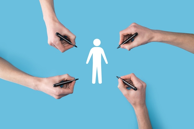 Several, four hands draw a man people human icon with a marker.hr human ,people icontechnology process system business with recruitment, hiring, team building.