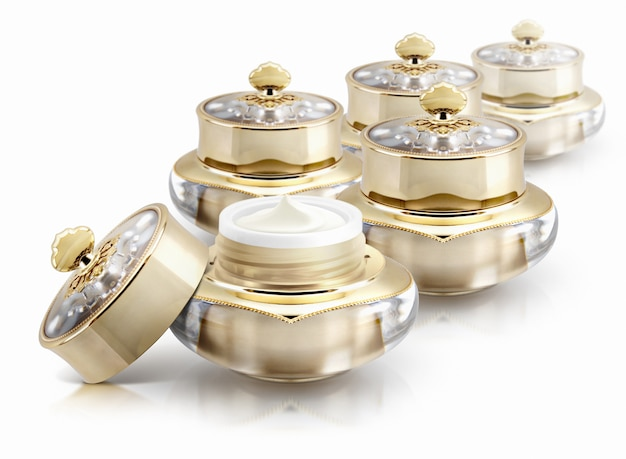 Several golden crown cosmetic jars