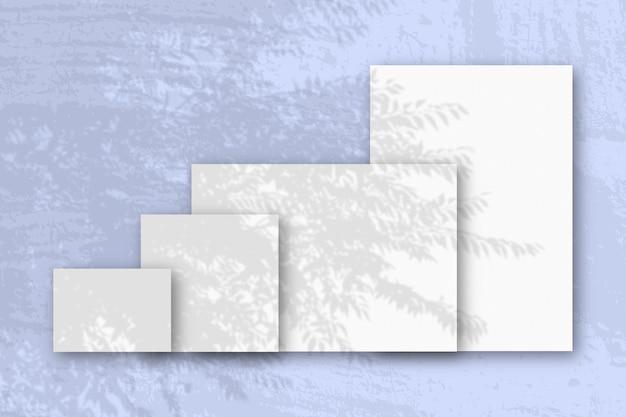 Несколько горизонтальных и вертикальных листов белой фактурной бумаги