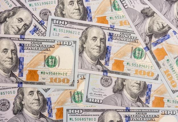 Several hundred dollars bills spread