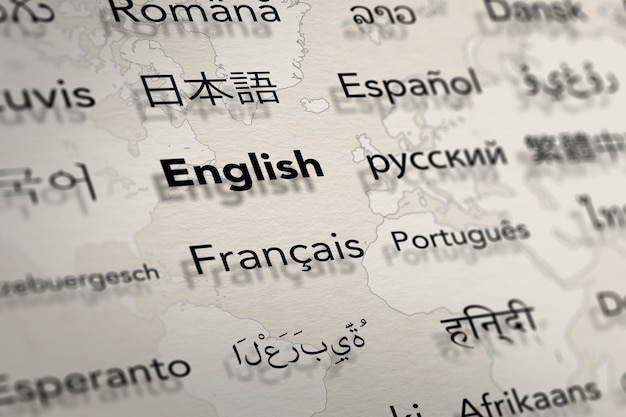 Several important languages on paper with world map background translate and languages education
