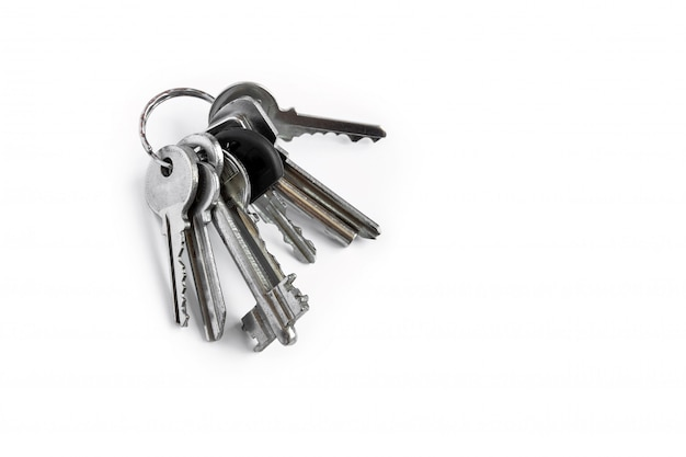Several keys on a white isolated ,the keys to the apartment.