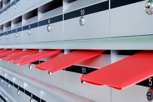 Several letterboxes with red envelopes