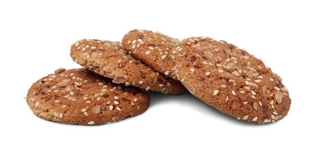 해바라기와 아마 씨 흰색 배경에 고립 된 여러 oatcakes. 건강 식품의 개념.