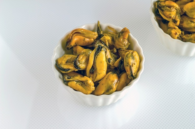Several open mussel shells on the plate