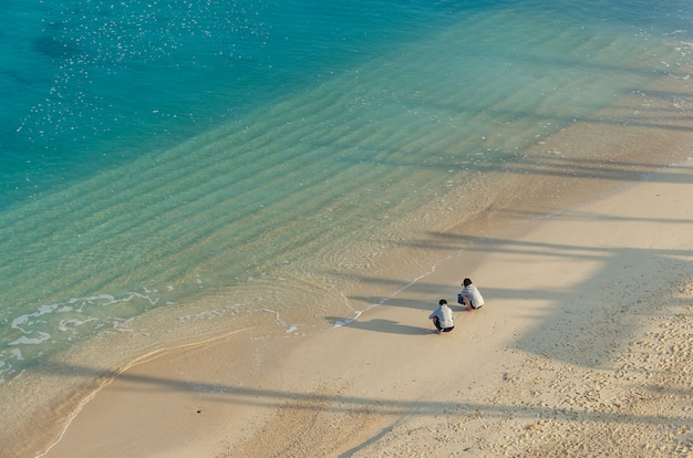 Several people on the beach of kouki in nago on okinawa island in japan.