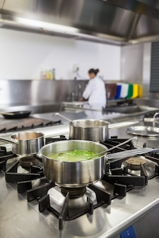 Several pots cooking on hotplate