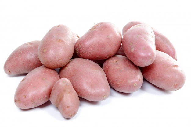 Several red potatoes isolated on white