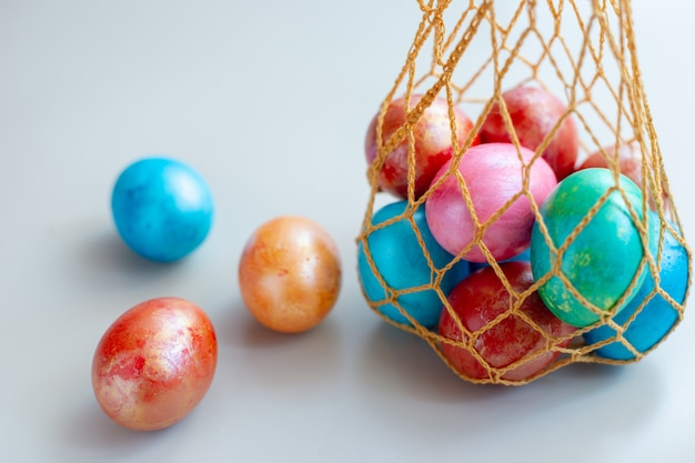Several ribbed eggs in a knitted bag