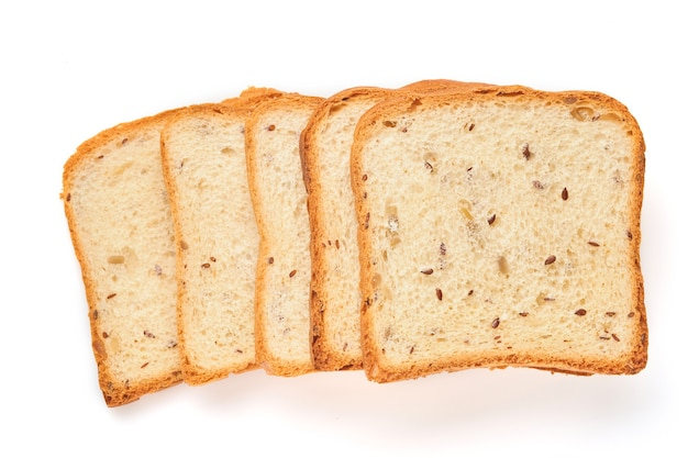 Several slices toast bread with pumpkin, poppy, flax, sunflower, sesame and millet seeds isolated on white table for proper nutrition. top view, flat lay