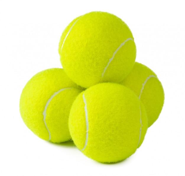 白い背景に分離されたいくつかのテニスボール