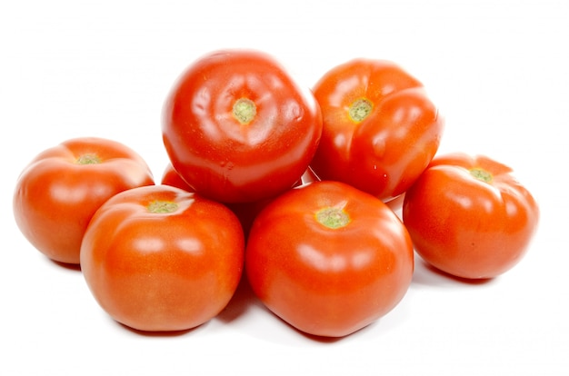 Several tomatoes  on white