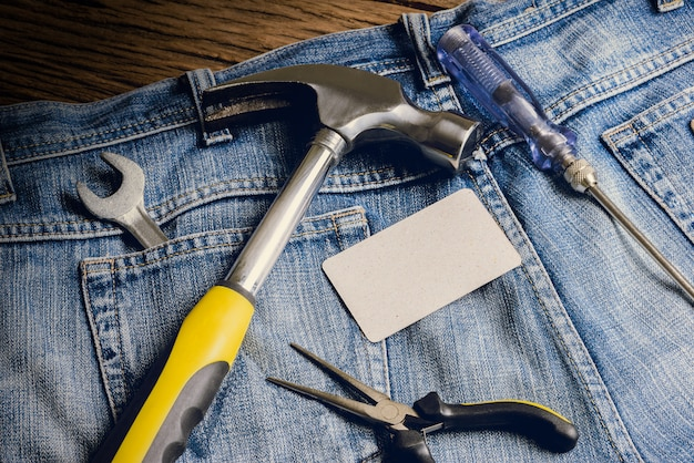 Several tools on a denim workers pocket