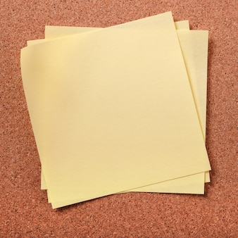 Several untidy sticky post notes on cork board
