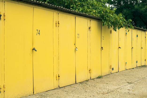 Several yellow numbered car garage outdoors