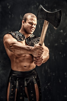 Severe barbarian in leather costume with hammer