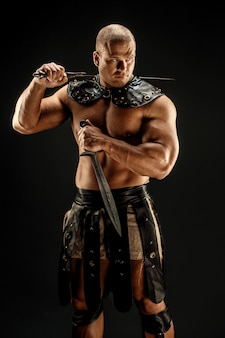 Severe barbarian in leather costume with sword