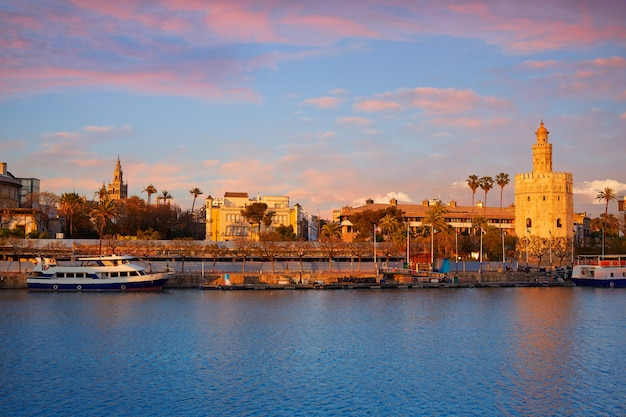 Seville sunset skyline torre del oro and giralda