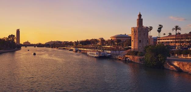 Seville sunset skyline torre del oro in sevilla