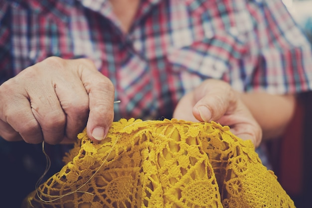 Sew machine closeup hand, sewing