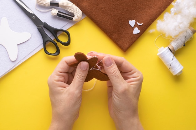 Sew two pieces of felt christmas gingerbread man together. step-by-step manufacturing instructions. step 4.