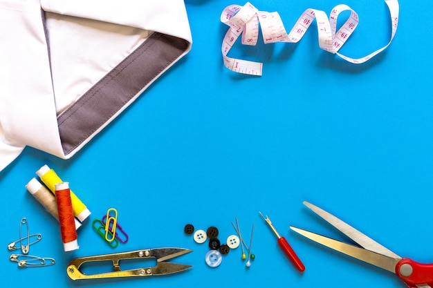 Sewing accessories on blue background