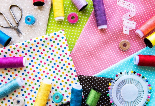 Sewing accessories and fabric. top view, flat lay.